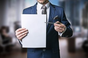 businessman-holding-empty-sheet-of-paper