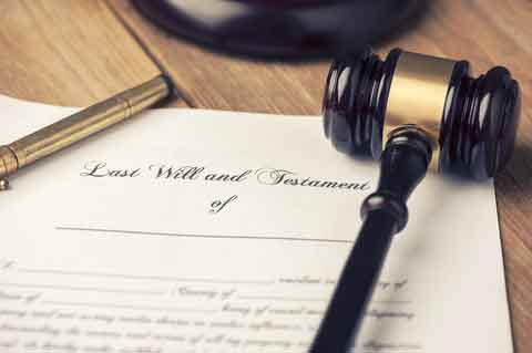 Last will and testament form with pen and gavel