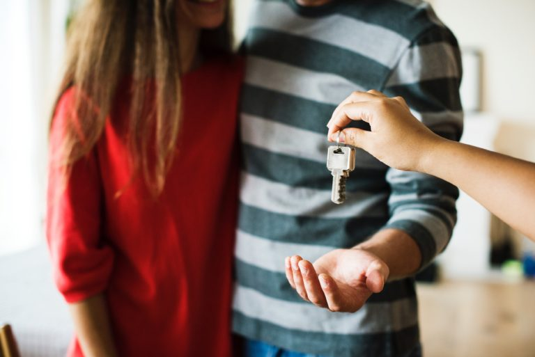 couple-getting-keys-to-new-edmonton-house-from-lawyer