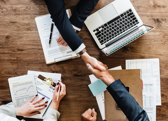 small-business-lawyers-reaching-across-table