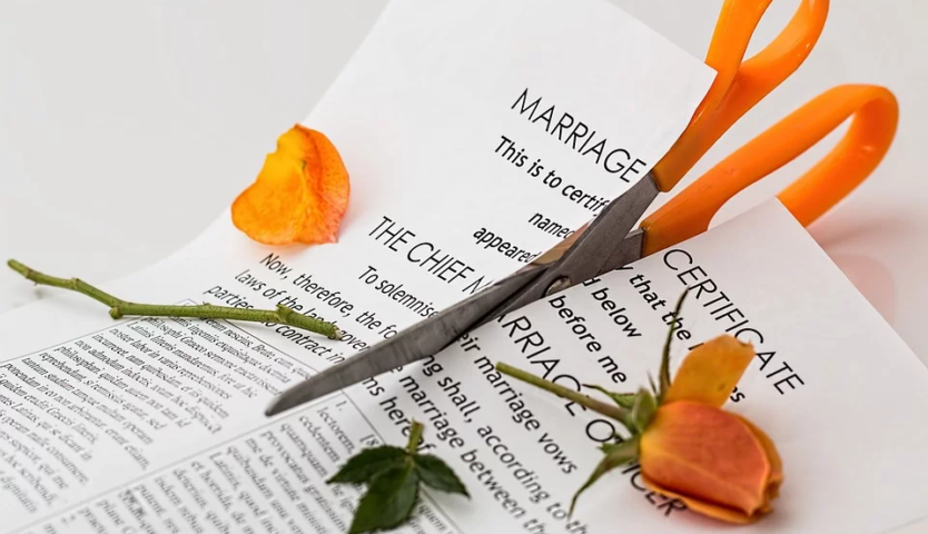 scissors-cutting-through-a-marriage-certificate