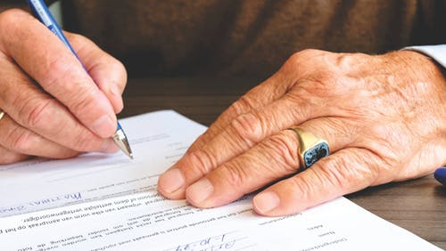 hands writing legal document