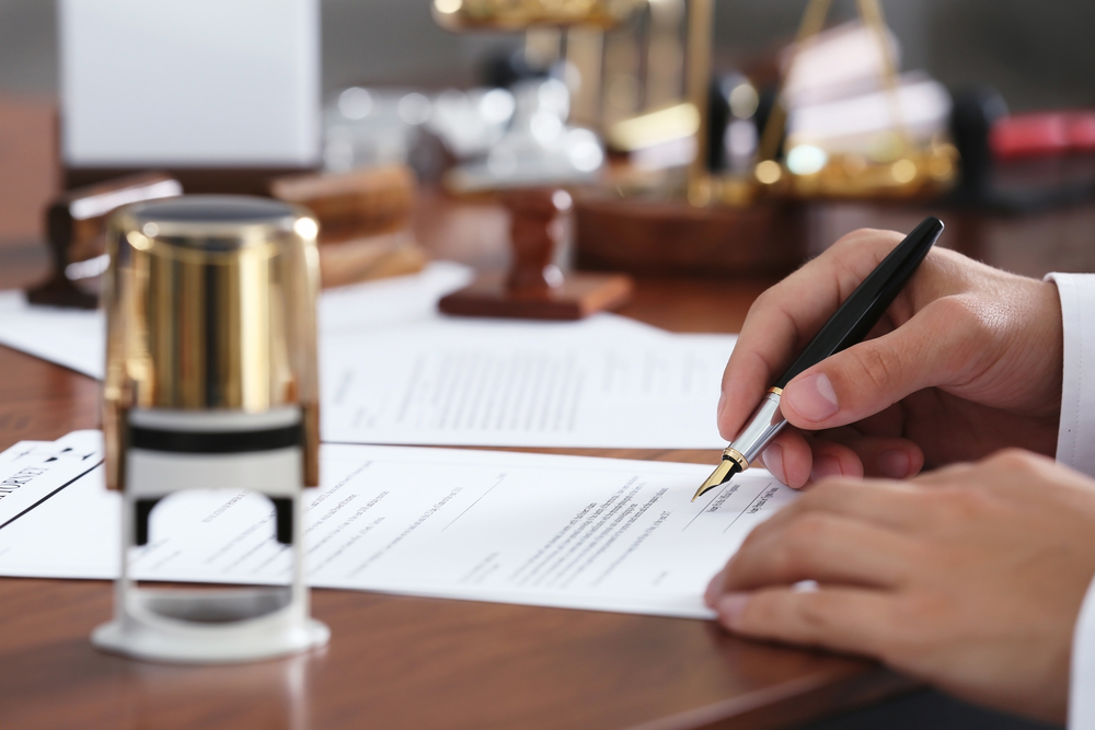 lawyer in office signing documents